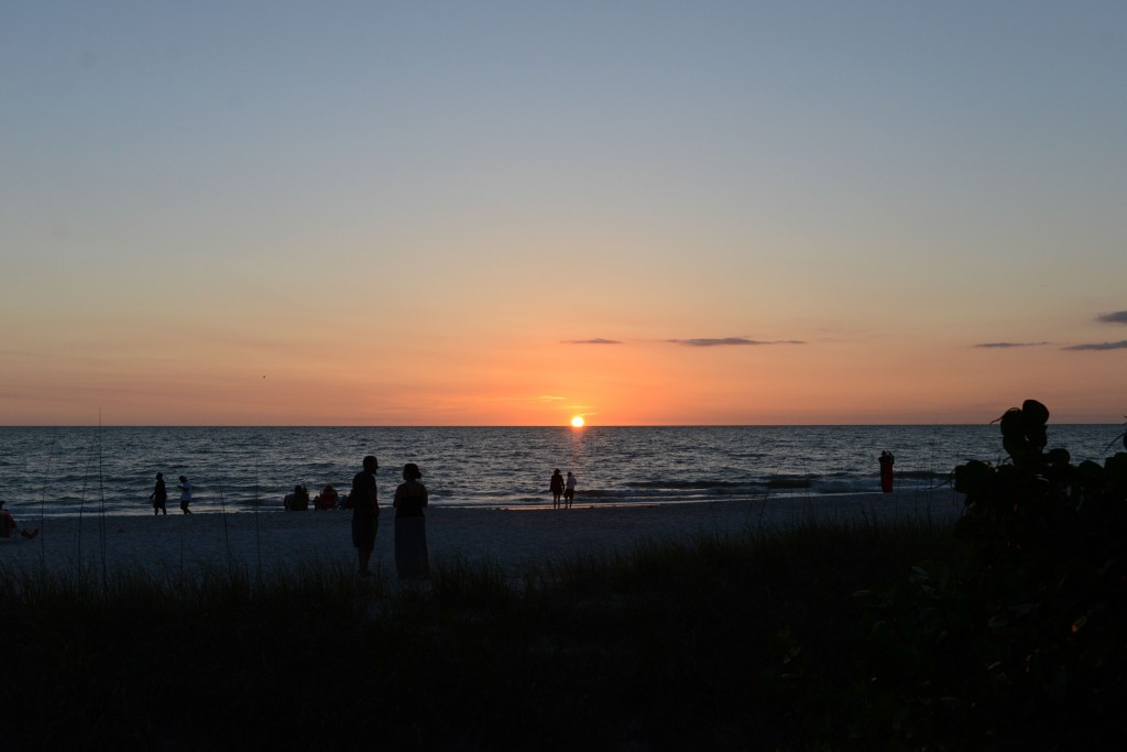 A sunset is seen on Naples beach in Naples, Florida on May 6, 2015. Photo by Ariel Min/PBS NewsHour