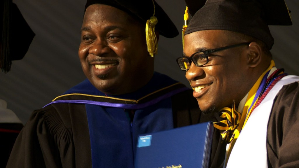 Interim South Carolina State University President W. Franklin Evans poses with students receiving diplomas at commencement in Orangeburg, South Carolina May 8, 2015. Photo by Kyla Calvert Mason/PBS NewsHour