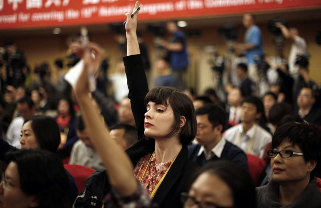 A foreign journalist raises her hand to ask a question during a news conference with Jiang Weixin, minister and secretary of the CPC Leadership Group of the Ministry of Housing And Urban-Rural Development, during the 18th National Party Congress (NPC) in Beijing November 12, 2012. At the last congress in 2007, top officials took one-on-one interviews, overseas reporters were encouraged to ask questions on whatever subject they wished and government media handlers went out of their way to be helpful, hoping to burnish China's global image ahead of the 2008 Olympic Games. This year, while economic officials and business leaders have generally been willing to talk, provincial leaders and rising political stars have largely shunned international media, and in some cases tried to avoid talking in public at all. Photo by Carlos Barria/Reuters