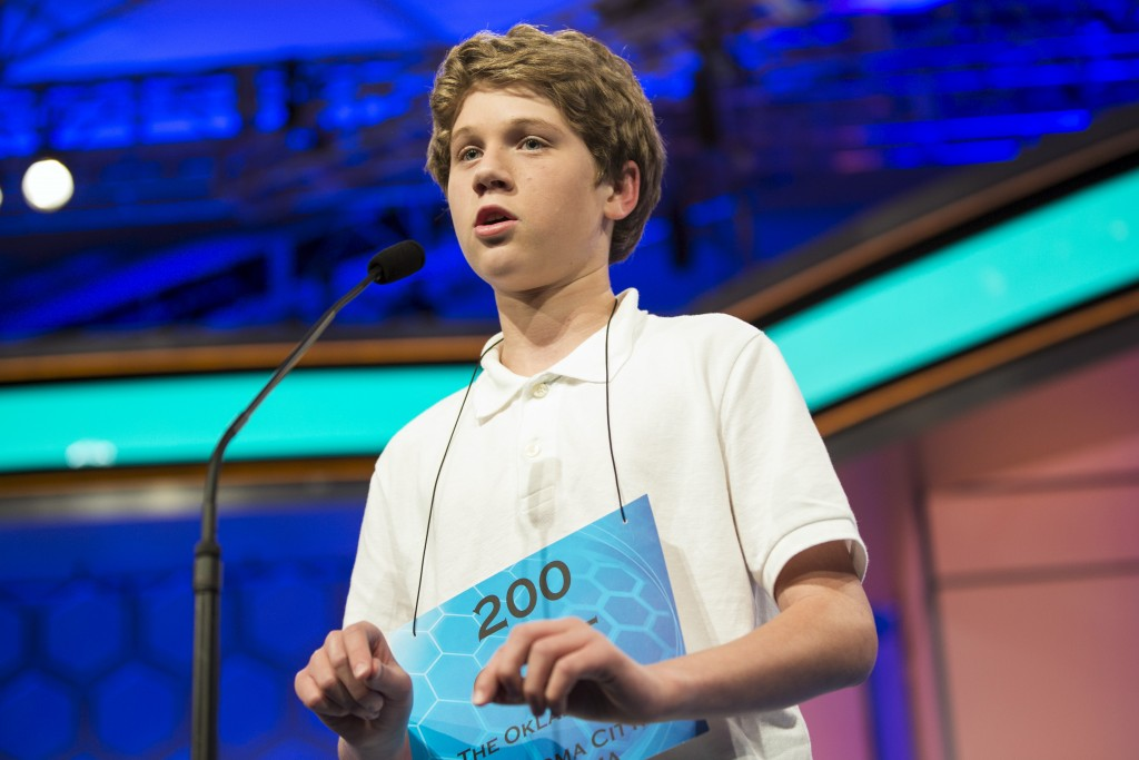"Cole Shafer-Ray of Oklahoma City, Oklahoma, spells ""commissurotomy"" during the final round of the 88th annual Scripps National Spelling Bee at National Harbor, Maryland May 28, 2015. REUTERS/Joshua Roberts"