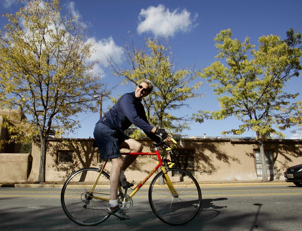 Then-presidential nominee John Kerry rides his bike in Santa Fe, New Mexico, October 12, 2004. Kerry broke his leg in a cycling accident Sunday, causing him to cut short an overseas trip. Photo by Jim Young/Reuters