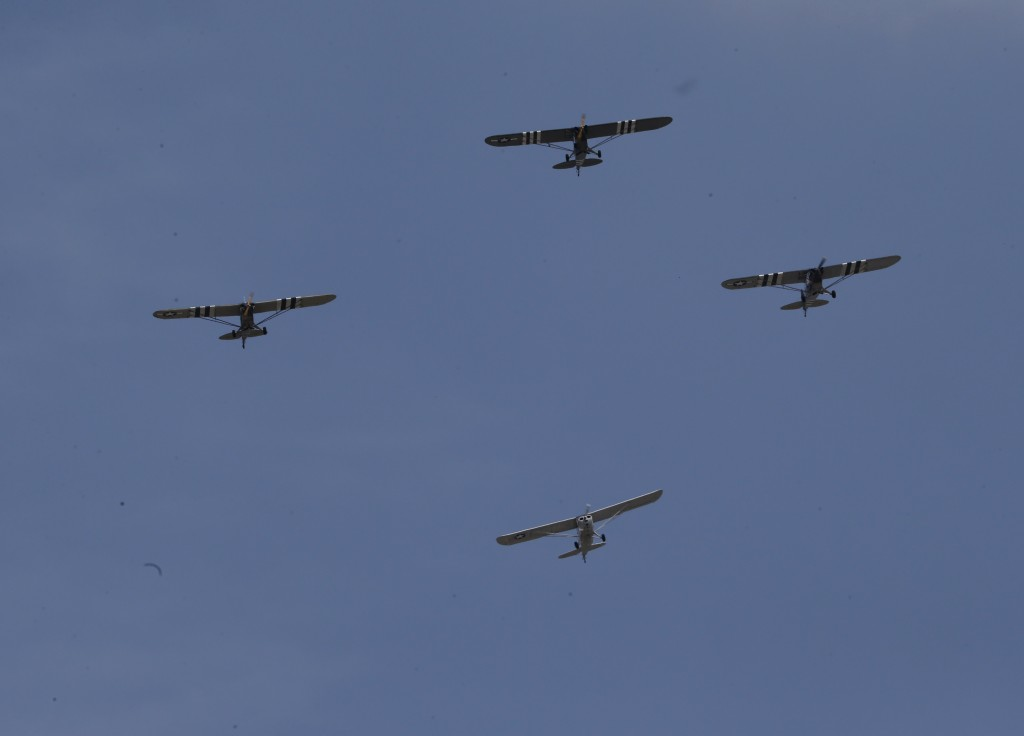 World War II era planes fly over the National Mall during a ceremony  to commemorate the 70th anniversary of VE (Victory in Europe) Day in Washington on May 8, 2015. Photo by Jim Bourg/Reuters