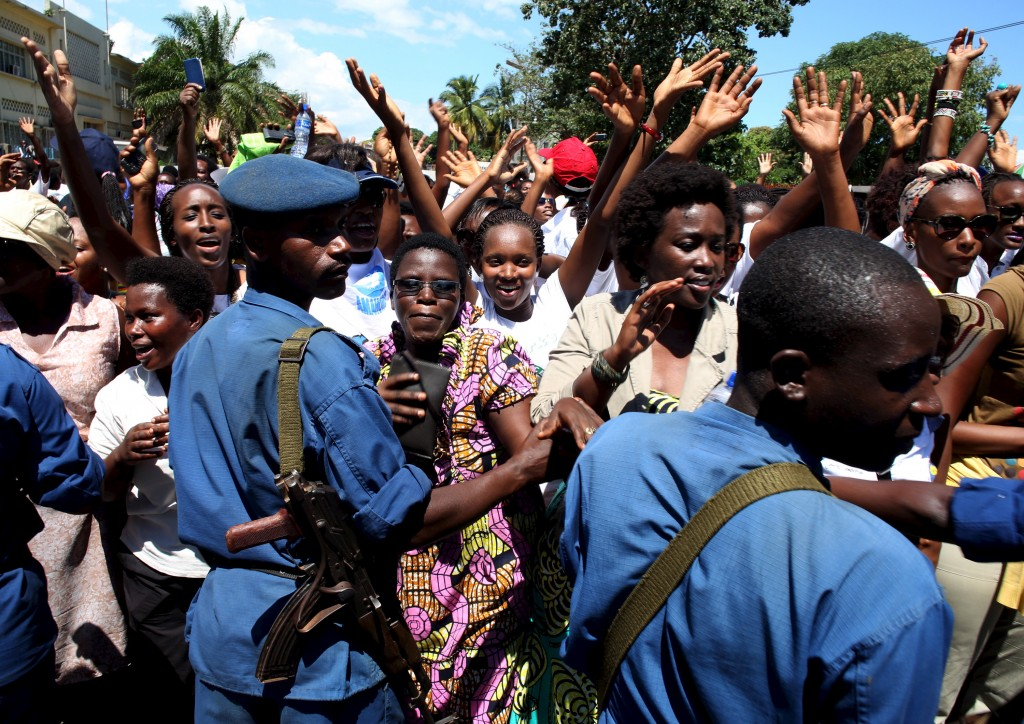 Women sing in front of police during a protest by women against president Pierre Nkurunziza in Bujumbura, Burundi, Sunday. Photo by Goran Tomasevic/Reuters