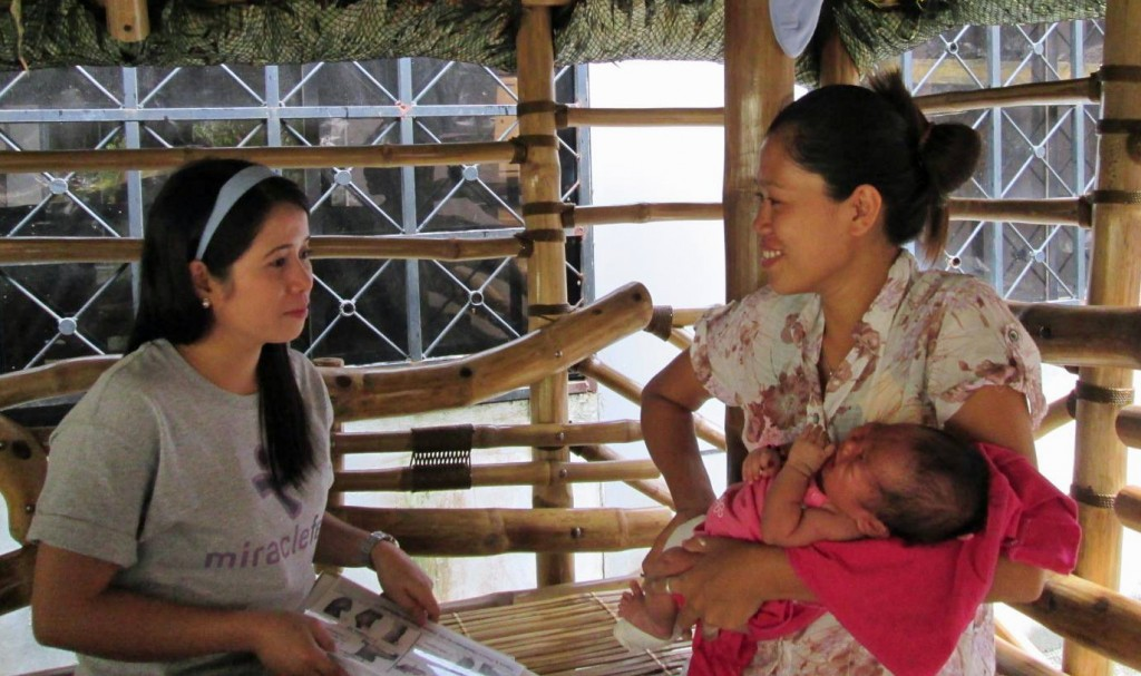 A counselor speaks with a mother at one of the clinics in the Philippines. Photo courtesy of miraclefeet