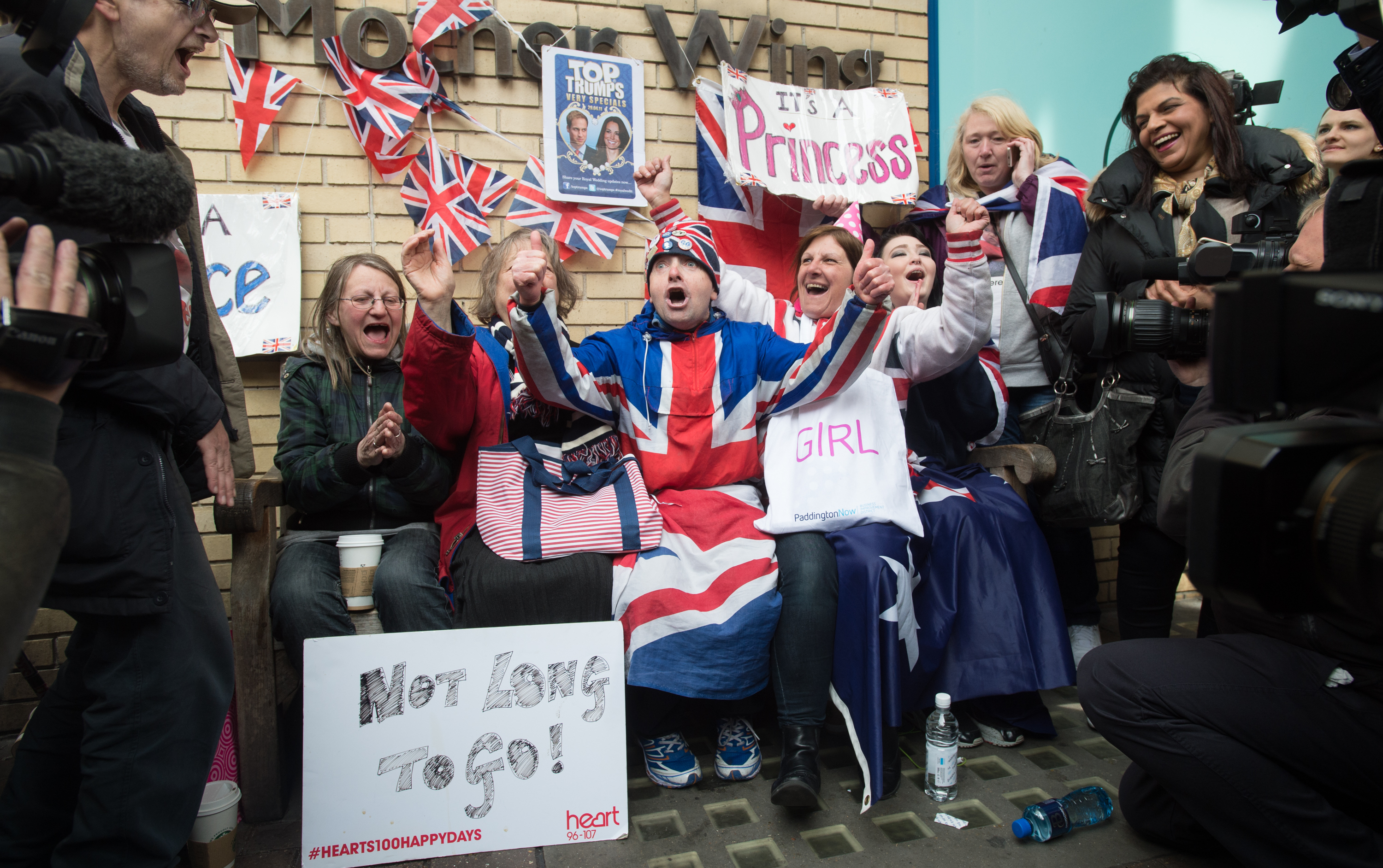 Royal fans celebrate the news the Duke and Duchess of Cambridge have given birth to a baby girl at St Mary's Hospital on May 2, 2015 in London, England. (Photo by Samir Hussein/WireImage)