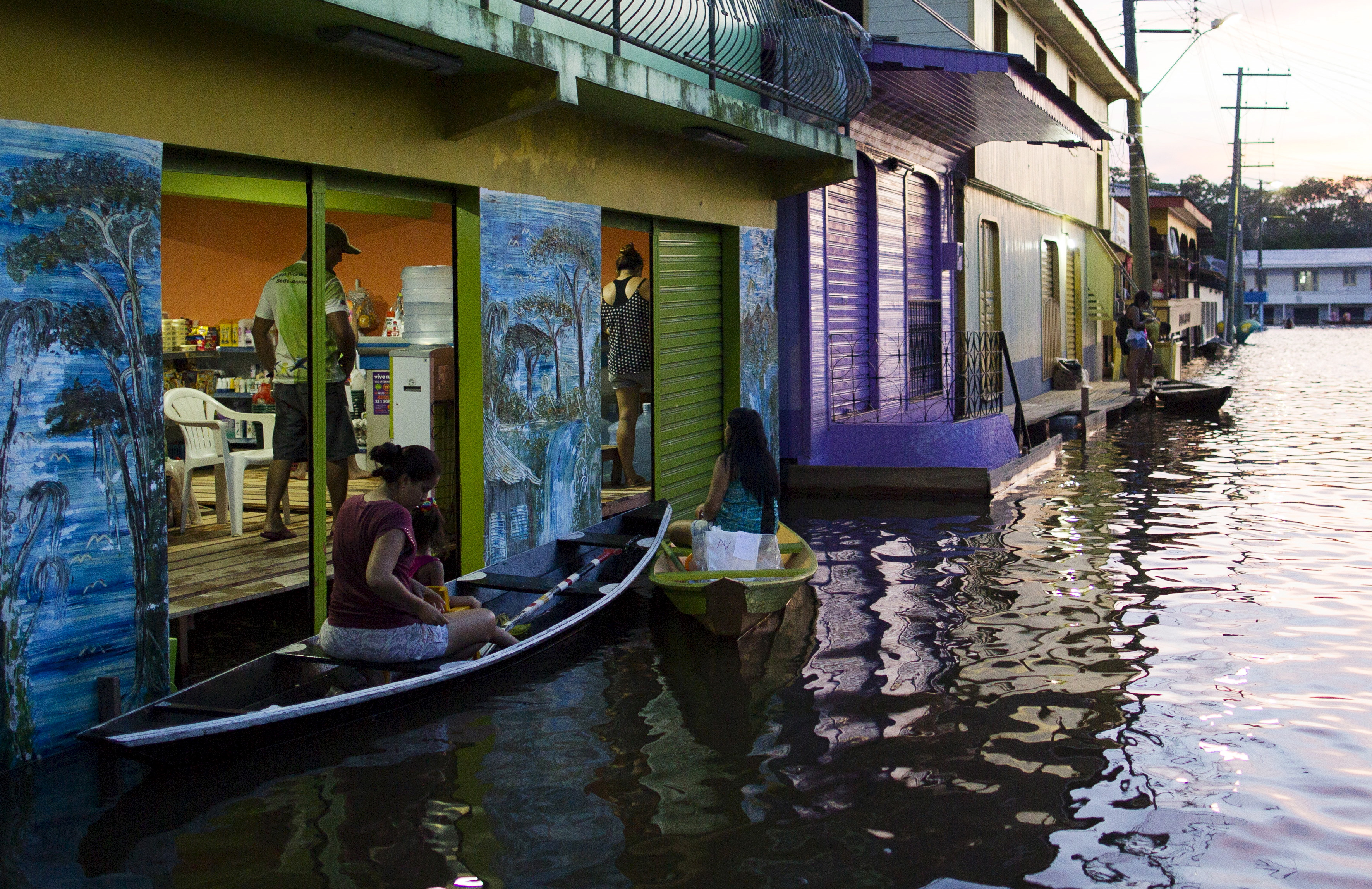 Residents canoed to a market in a street flooded by the rising Rio Solimoes, one of the two main branches of the Amazon River, in Anama, Amazonas state, Brazil on June 3, 2015. Photo by Bruno Kelly/Reuters