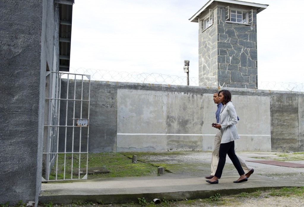 President Barack Obama and first lady Michelle Obama tour Robben Island in South Africa where anti-apartheid activist Nelson Mandela was once jailed, on June 30, 2013. Photo by Saul Loeb/AFP/Getty Images