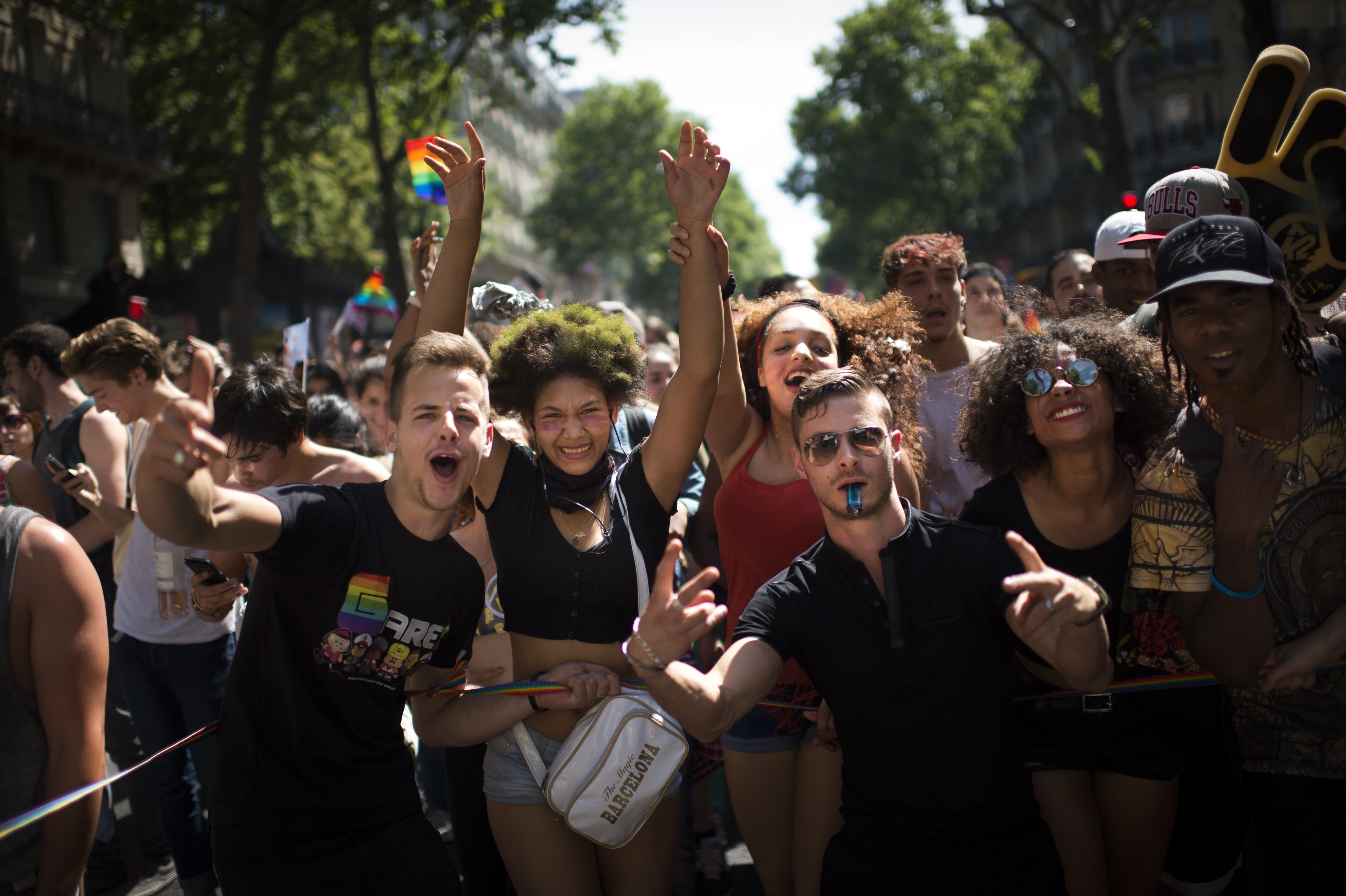 People take part in the annual Gay Pride homosexual, bisexual and transgender visibility march on June 27, 2015 in Paris. AFP PHOTO / MARTIN BUREAU (Photo credit should read MARTIN BUREAU/AFP/Getty Images)