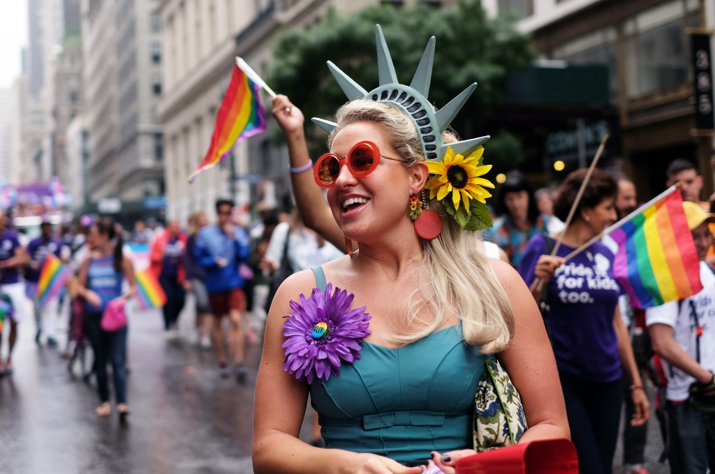 A participant smiles during the 2015 New York City Pride march in New York on June 28, 2015. Under a sea of rainbow flags, hundreds of thousands of jubilant supporters poured onto New York's streets for the annual Gay Pride March, two days after the US Supreme Court's landmark ruling to legalize gay marriage. AFP PHOTO/JEWEL SAMAD (Photo credit should read JEWEL SAMAD/AFP/Getty Images)