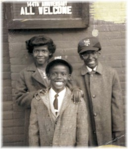 Gwen, age 10, with her brothers outside the AME church in Buffalo, New York.