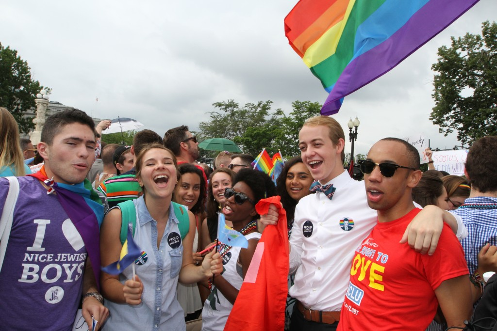 A group celebrates the Supreme Court's decision on marriage equality on June 26, 2015. (Photo by Corinne Segal)
