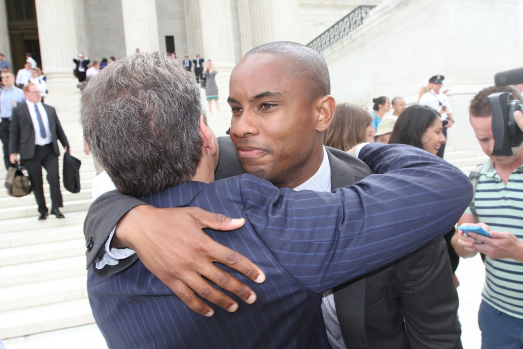 Jamal Brown (right) celebrates the Supreme Court decision on marriage equality on June 26, 2015. (Photo by Corinne Segal)
