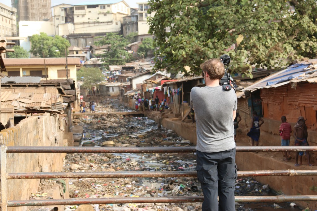 Cinematographer Cameron Hickey shoots in the Kroo Bay slum of Freetown, Sierra Leone for Miles O'Brien's four-part series, Cracking Ebola's code