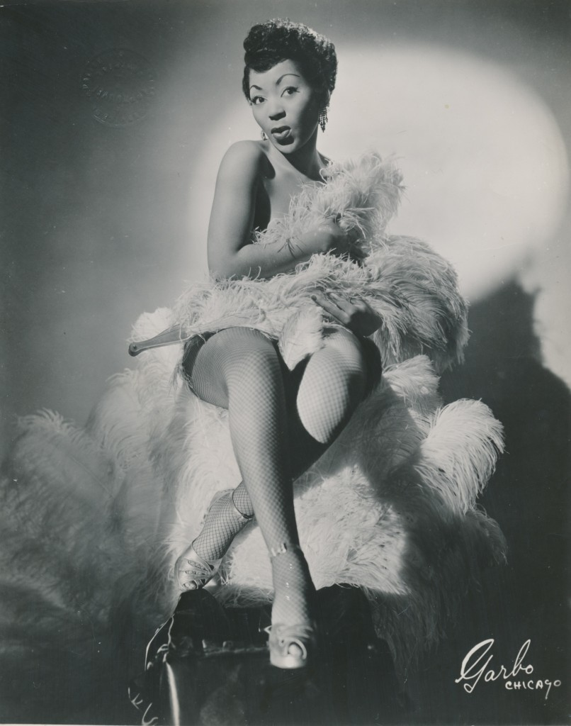 Jean Idelle, one of the first African American women to perform in an all white burlesque troupe, poses for the camera.