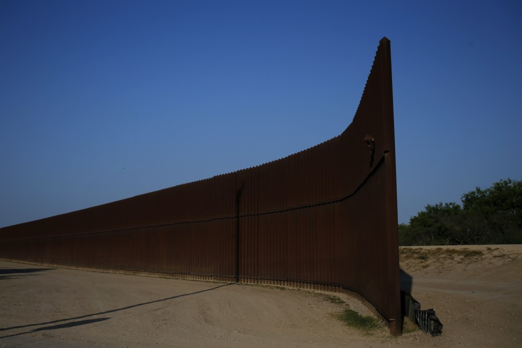 A break in the border fence at the United States-Mexico border is seen outside of Brownsville, Texas