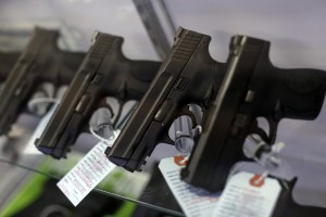 Handguns are seen for sale in a display case at Metro Shooting Supplies in Bridgeton, Missouri, November 13, 2014. The store has reported an increase in gun sales as the area waits for a grand jury to reach a decision this month on whether to indict Darren Wilson, the white police officer who shot and killed the 18-year-old Mike Brown, who was black, on Aug. 9 in the St. Louis suburb of Ferguson. REUTERS/Jim Young (UNITED STATES - Tags: CRIME LAW CIVIL UNREST POLITICS) - RTR4E2JK