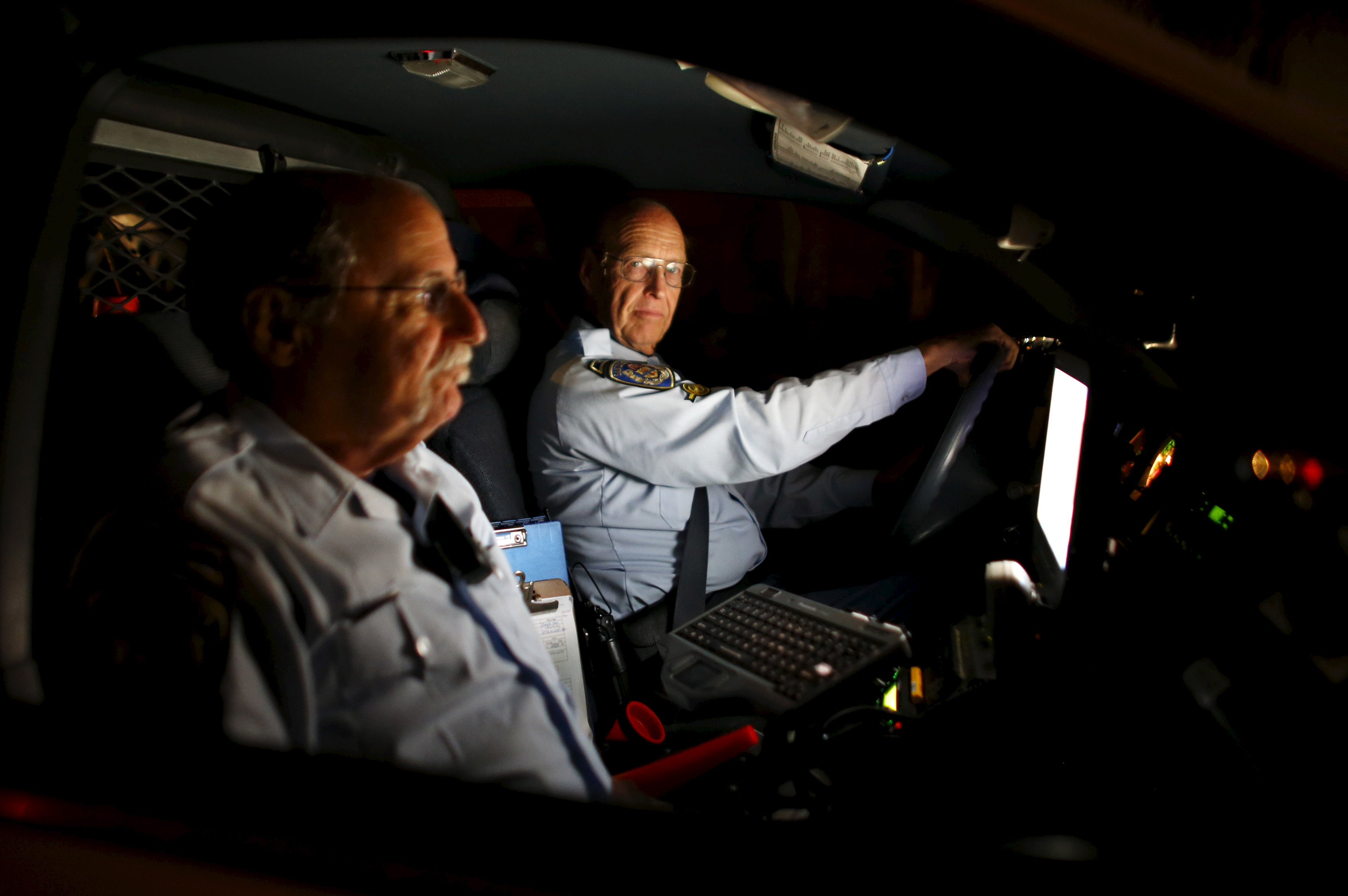 RSVP member Henry Miller drives on patrol with partner Steve Rubin (L) as they search for a vehicle involved in a hit and run accident in San Diego, California on March 10, 2015. Photo by Mike Blake/Reuters