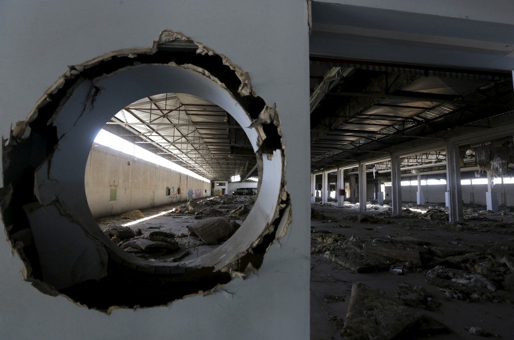 The interior of a deserted textile factory that closed in 1995 is seen near the town of Larissa in Thessaly region, Greece April 22, 2015. Photo by Yannis Behrakis/Reuters