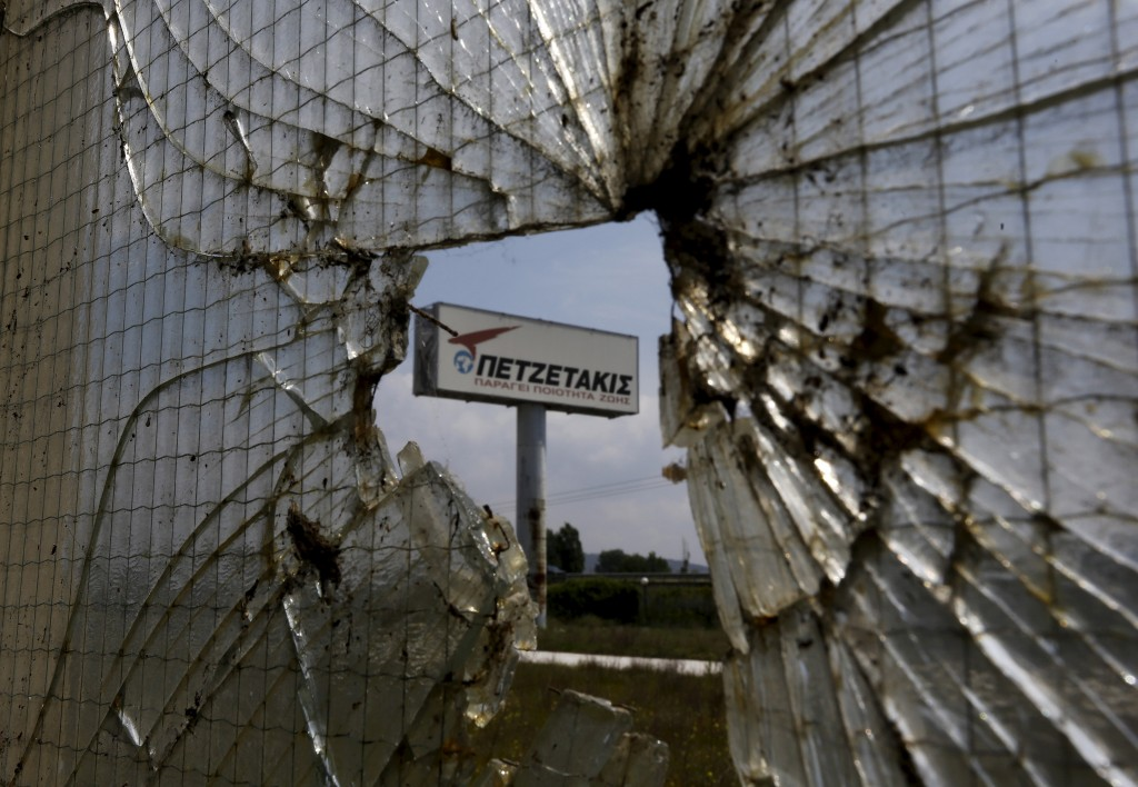 The sign of a plastic tube factory that closed in 2011 is seen near the town of Kavala in Thrace region, Greece April 25, 2015. Photo by Yannis Behrakis/Reuters