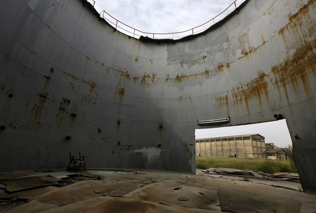 A destroyed silo is seen in a deserted cooking oil factory that closed in 1996 in the town of Elefsina in Sterea Hellas region, Greece April 28, 2015. Photo by Yannis Behrakis/Reuters