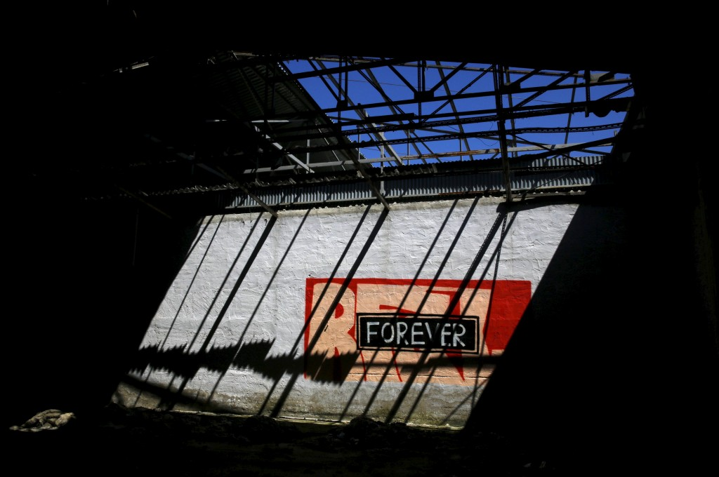 Graffiti on the walls of a deserted textile factory that closed in 1995 near the town of Larissa in Thessaly region, Greece April 22, 2015. Photo by Yannis Behrakis/Reuters