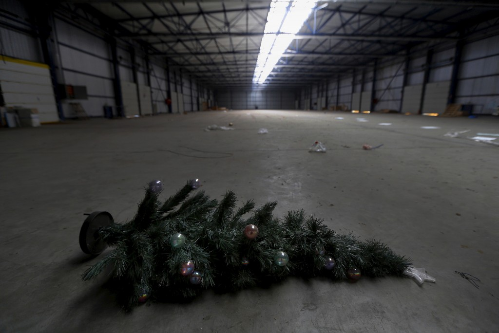 A Christmas tree is seen on the floor of a logistics and international transportation company that closed in 2012 in the town of Thessaloniki in central Macedonia region, Greece April 23, 2015. Photo by Yannis Behrakis/Reuters
