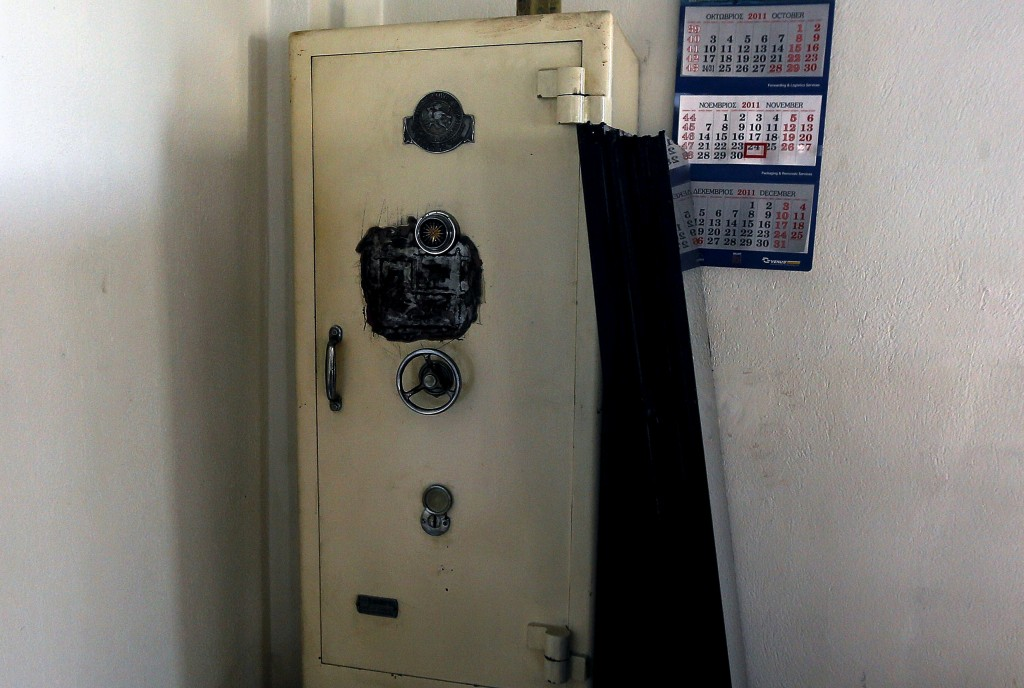 A safe is seen inside an office at a logistics and international transportation company that closed in 2012 in the town of Thessaloniki in central Macedonia region, Greece April 23, 2015. Photo by Yannis Behrakis/Reuters