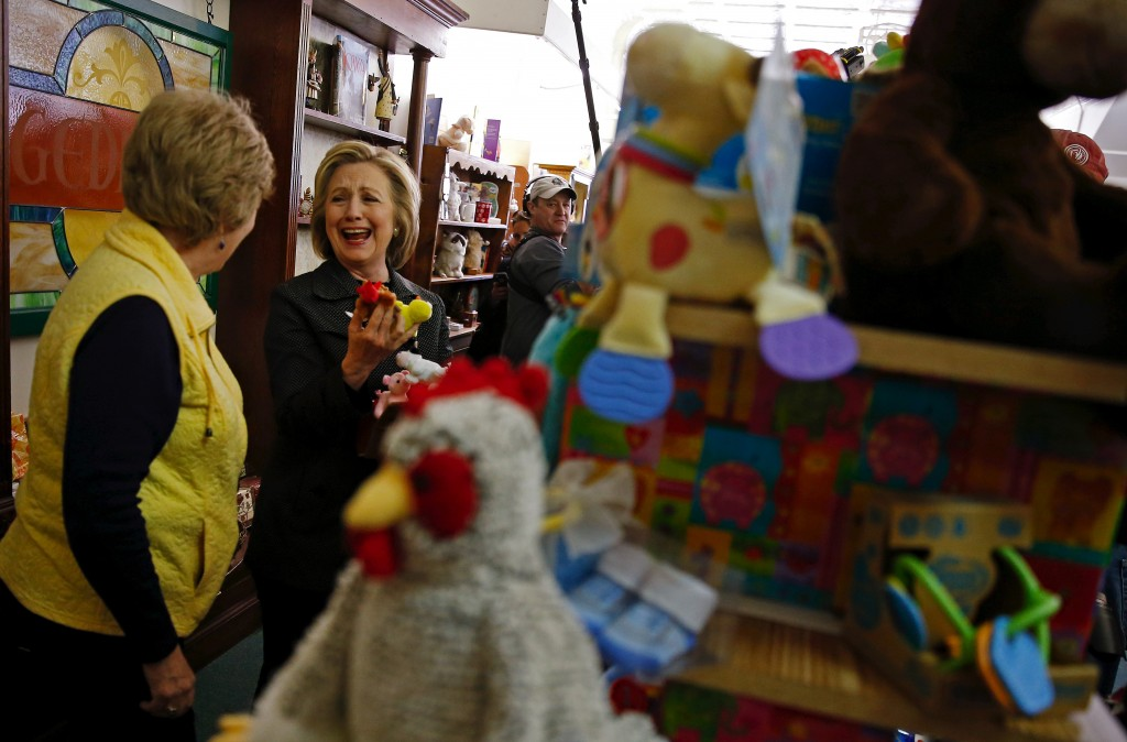 U.S. presidential candidate Hillary Clinton laughs at a toy while shopping in Independence, Iowa, United States, May 19, 2015.    REUTERS/Jim Young   - RTX1DOCU