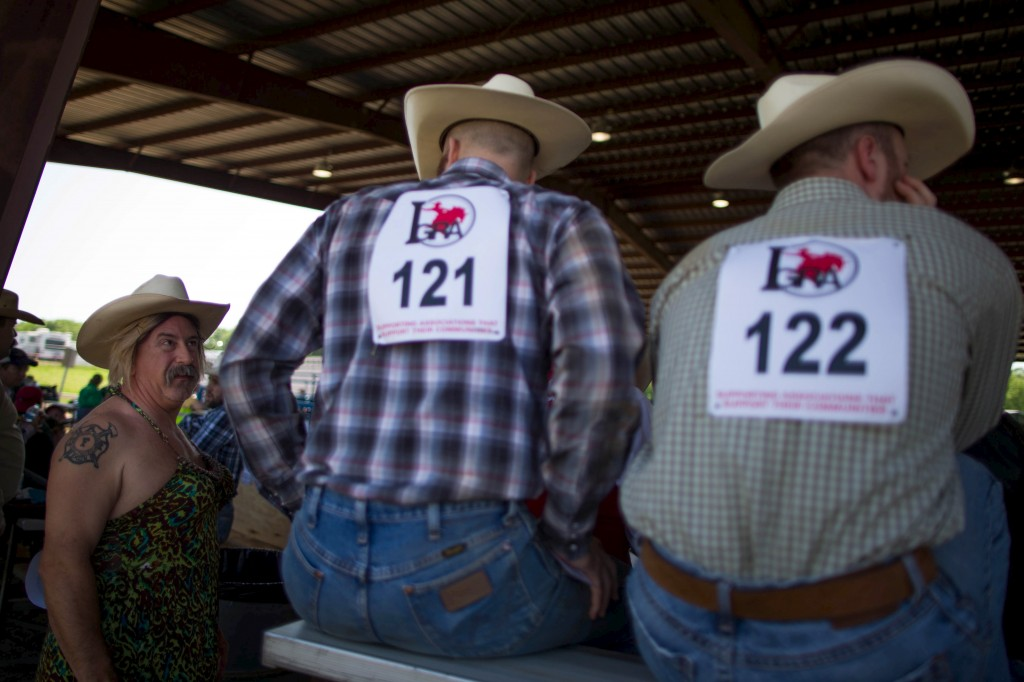 Greg Smith, 47, from Alabama chats with a cowboy as he waits to compete in the Wild Drag Race at the International Gay Rodeo Association's Rodeo In the Rock in Little Rock, Arkansas, United States April 25, 2015. Photo by Lucy Nicholson/Reuters