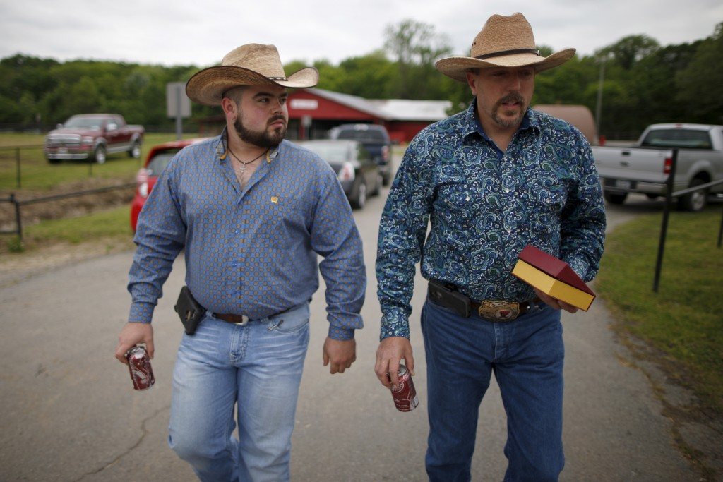 Wade Earp, 49, (R) and his husband Jonathan Suder, 25, from Dallas walk to the International Gay Rodeo Association's Rodeo In the Rock party in Little Rock, Arkansas, United States April 26, 2015. Photo by Lucy Nicholson/Reuters