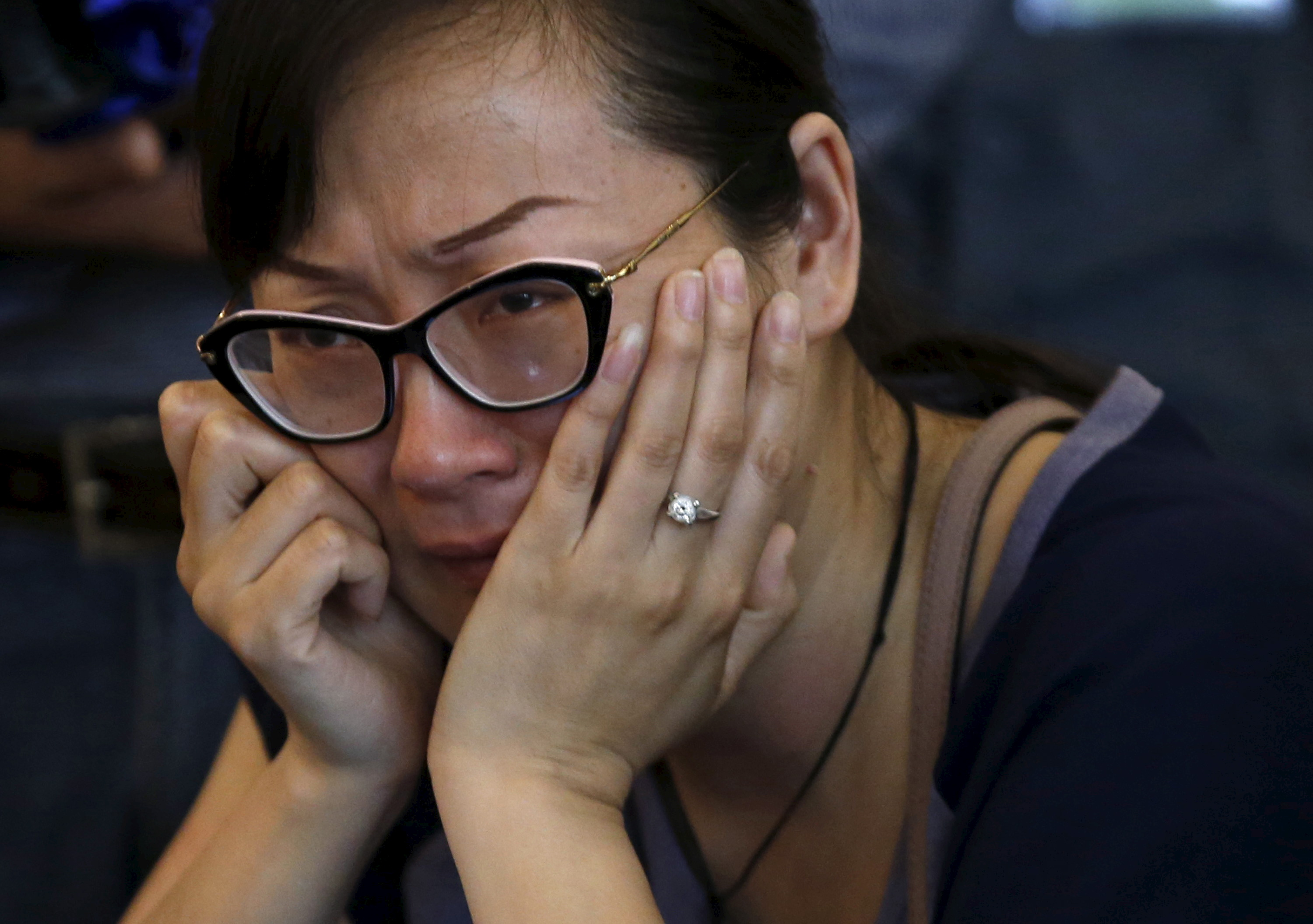 A family member of a passenger aboard the capsized ship Eastern Star cries during the government's daily briefing in Jianli, Hubei province, China, June 6, 2015. Kim Kyung-Hoon/Reuters