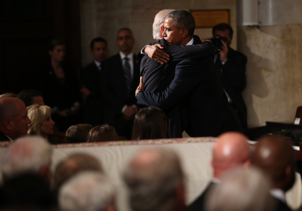 U.S. President Barack Obama (R) hugs Vice President Joe Biden during the funeral of former Delaware Attorney General Beau Biden, son of Vice President Joe Biden, at St. Anthony of Padua Church in Wilmington, Delaware June 6, 2015. Photo by Doug Mills/REUTERS