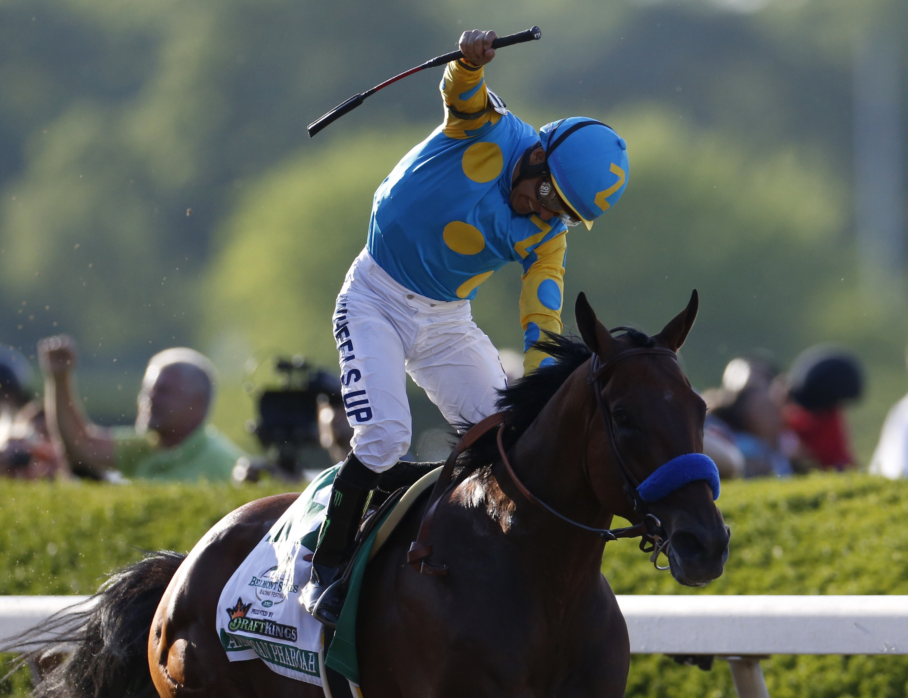 Espinoza celebrates after winning the Triple Crown. Photo by Shannon Stapleton/Reuters
