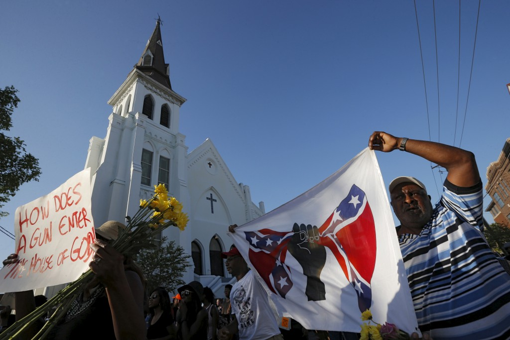 "The ""March for Black Lives"" passes by the Emanuel African Methodist Episcopal Church in Charleston, South Carolina June 20, 2015 three days after a mass shooting left people nine dead during a bible study at the church.     REUTERS/Brian Snyder - RTX1HEVH"