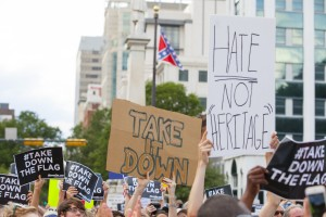 People hold signs during a protest asking for the removal of the confederate battle flag at the South Carolina State House in Columbia, South Carolina. Photo by Jason Miczek/Reuters