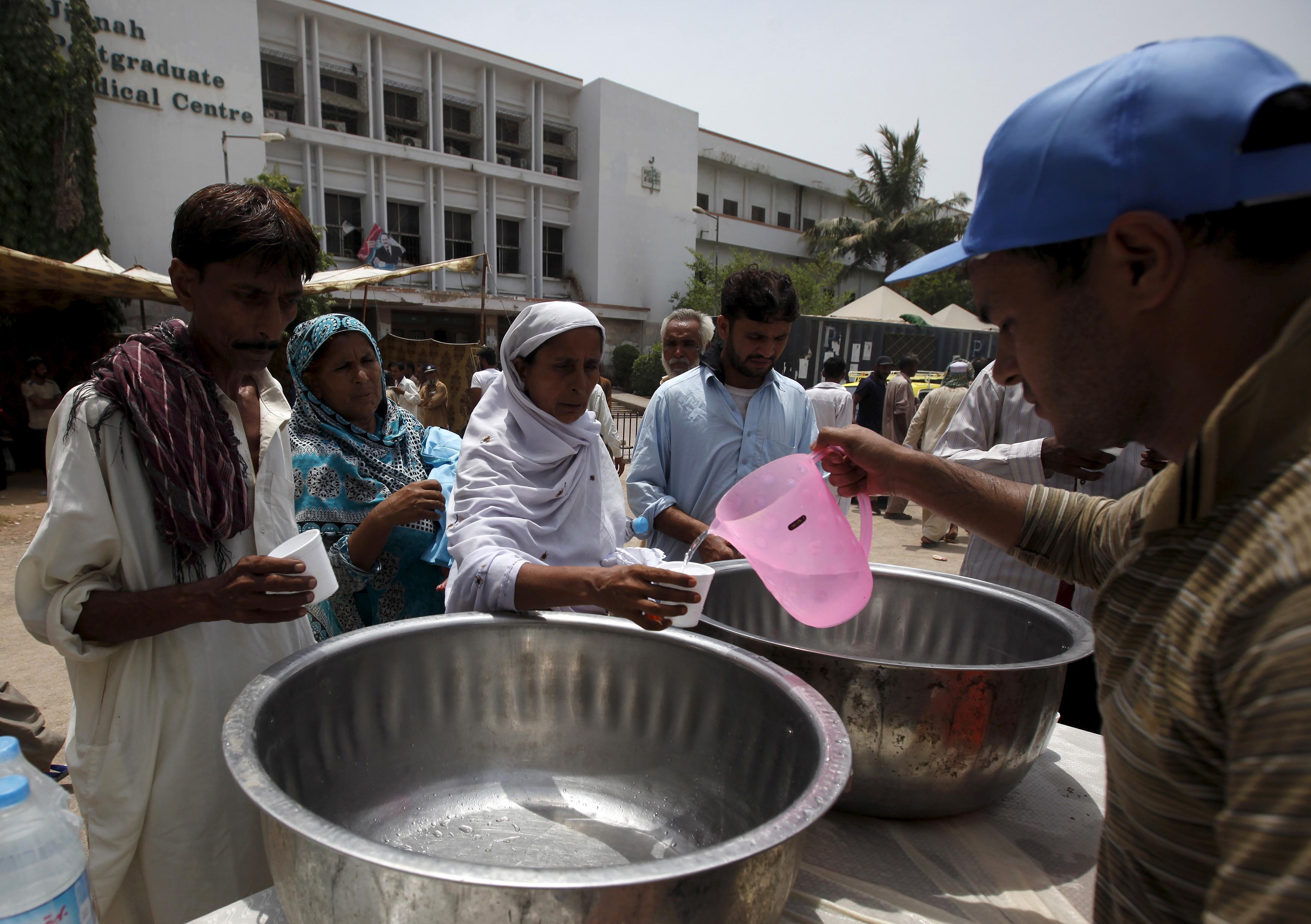 Volunteers hand out drinking water outside the Jinnah Postgraduate Medical Center in Karachi, Pakistan on June 23. Photo by Akhtar Soomro/Reuters