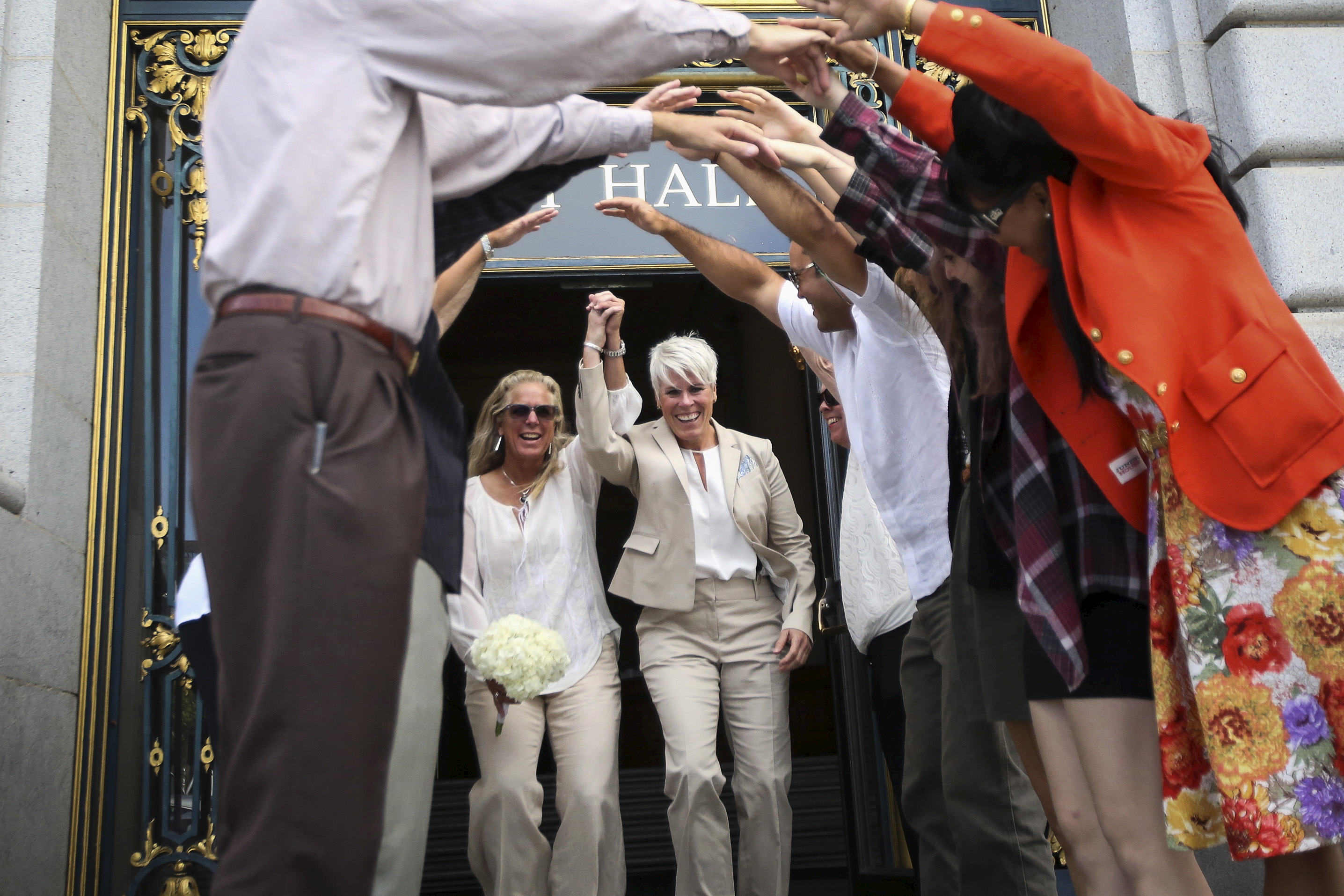 "Stacy Wood, (L) and her wife Michele Barr leave San Francisco City Hall after getting married in San Francisco, California June 26, 2015. Earlier in the day the Supreme Court ruled 5-4 that the Constitution's guarantees of due process and equal protection under the law mean that states cannot ban same-sex marriages. With the ruling, gay marriage will become legal in all 50 states. Barr and Wood have been together for almost 29 years. ""We didn't realize when we picked this date that it would be such a monumental day for the country,"" said Barr. ""We just thought the Supreme Court wanted to give us a really great wedding gift. Now we just need to know where to send the thank you card."" REUTERS/Elijah Nouvelage TPX IMAGES OF THE DAY - RTX1I0FZ"