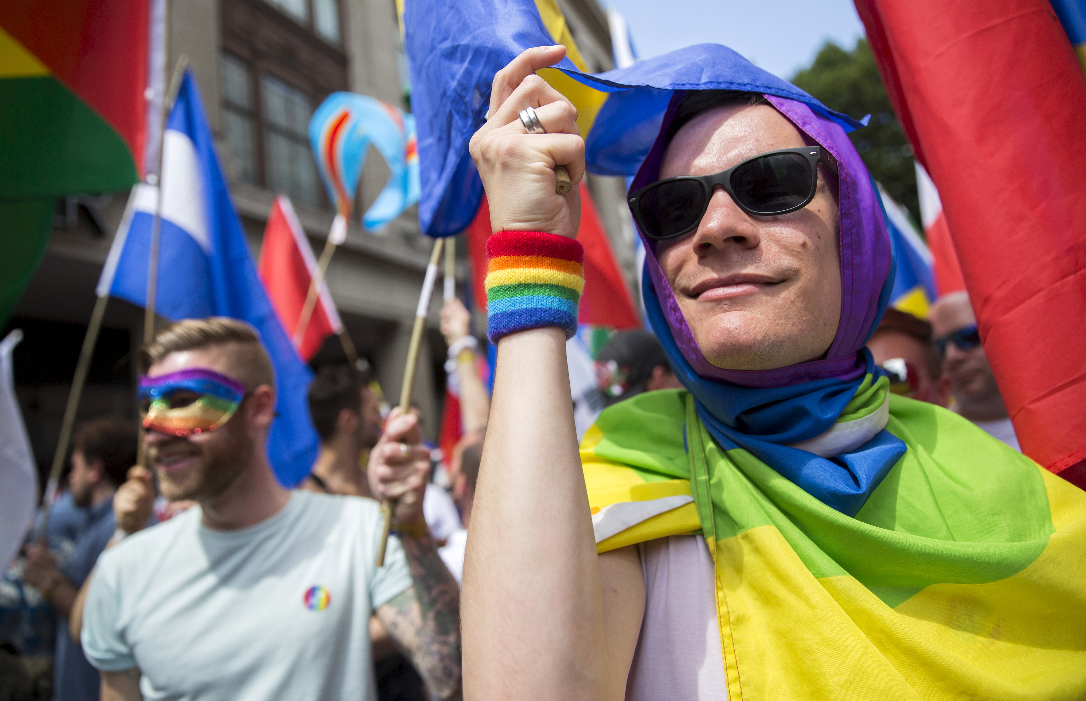 Participants take part in the annual Pride London Parade which highlights issues of the gay, lesbian and transgender community, in London, Britain June 27, 2015. REUTERS/Neil Hall - RTX1I1VX