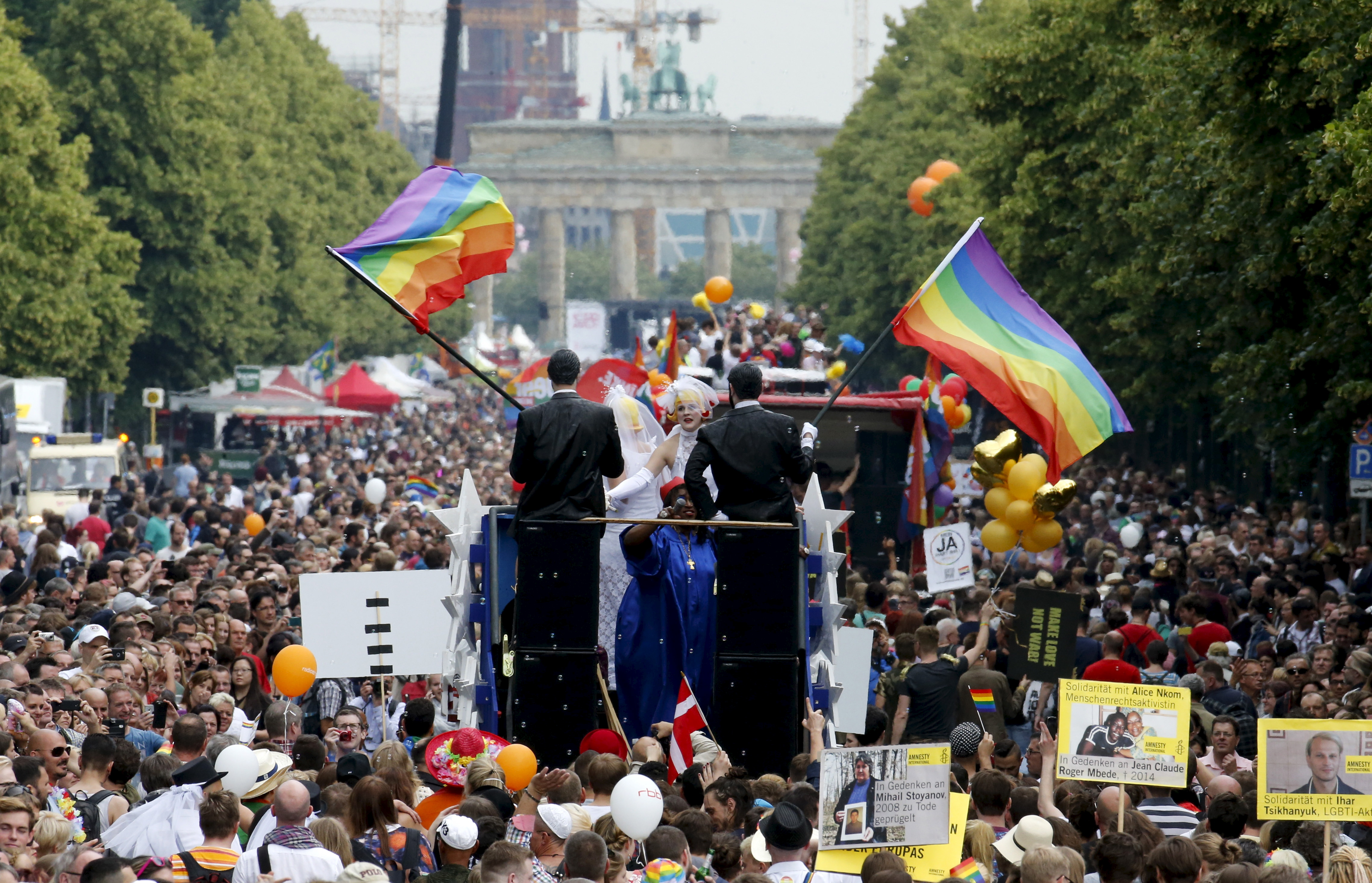 People participate in the annual Christopher Street Day parade, held in celebration and demonstration of the rights of LBGT people, in front of the Brandenburg Gate in Berlin, Germany, June 27, 2015. Photo by Fabrizio Bensch/Reuters