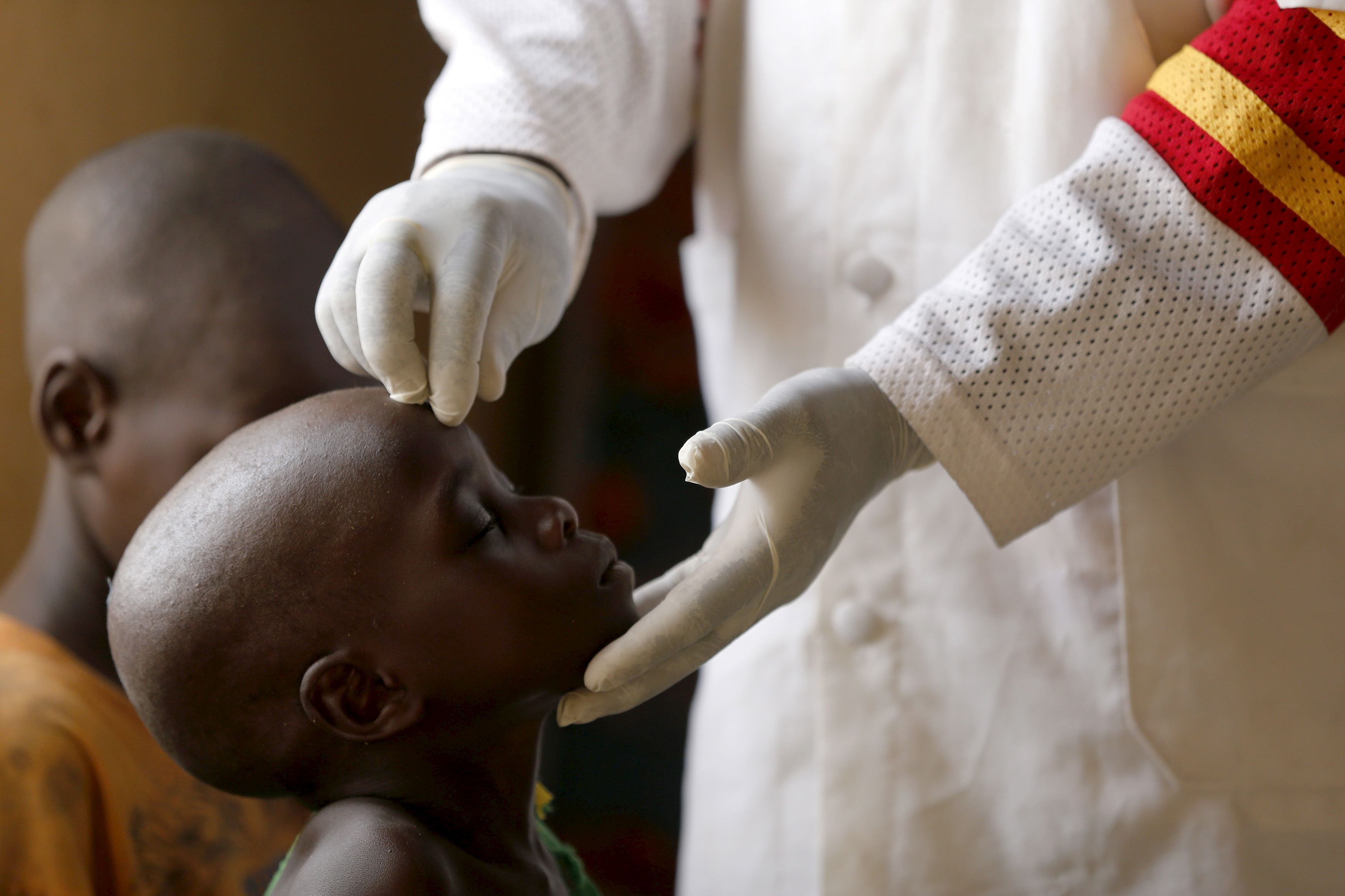 A child rescued from Boko Haram in Sambisa forest is treated at a clinic at the Internally Displaced People's camp in Yola, Nigeria, on May 3, 2015. Photo by Afolabi Sotunde/Reuters