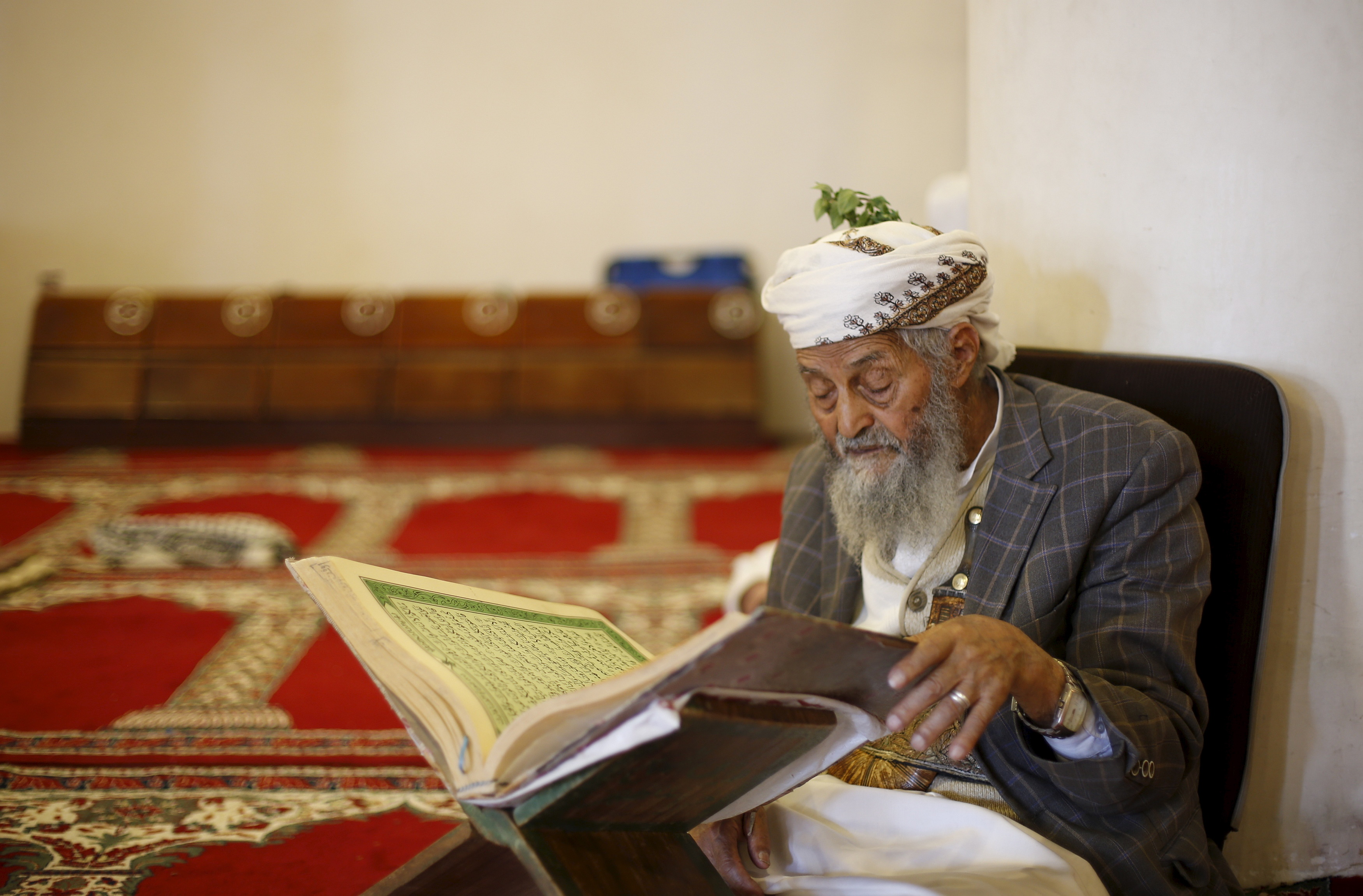 A man reads the Quran at the Grand Mosque in Yemen's capital Sanaa ahead of the holy month of Ramadan on June 17, 2015. Photo by Khaled Abdullah/Reuters
