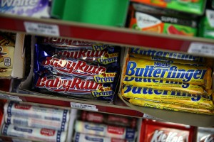 SAN FRANCISCO, CA - FEBRUARY 18:  Nestle Butterfinger and Baby Ruth candy bars are displayed on a shelf at a convenience store on February 18, 2015 in San Francisco, California.  Nestle USA announced plans to remove all artificial flavors and FDA-certified colors from its entire line of chocolate candy products, including the popular Butterfinger and Baby Ruth candy bars, by the end of 2015. Photo by Justin Sullivan/Getty Images