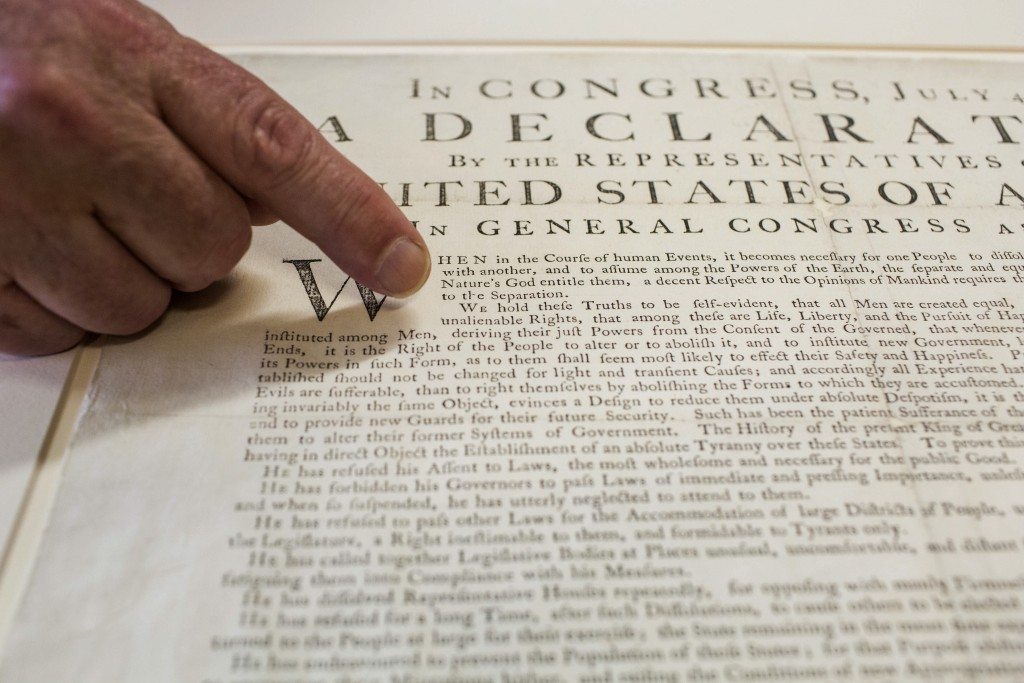 Peter Drummey, chief reference librarian of the Massachusetts Historical Society, points to a rare copy of the Declaration of Independence, known as a 'Dunlap Broadside,' at the society in Boston, Massachusetts, U.S., on June 29, 2015. Photo by Shiho Fukada/Bloomberg via Getty Images