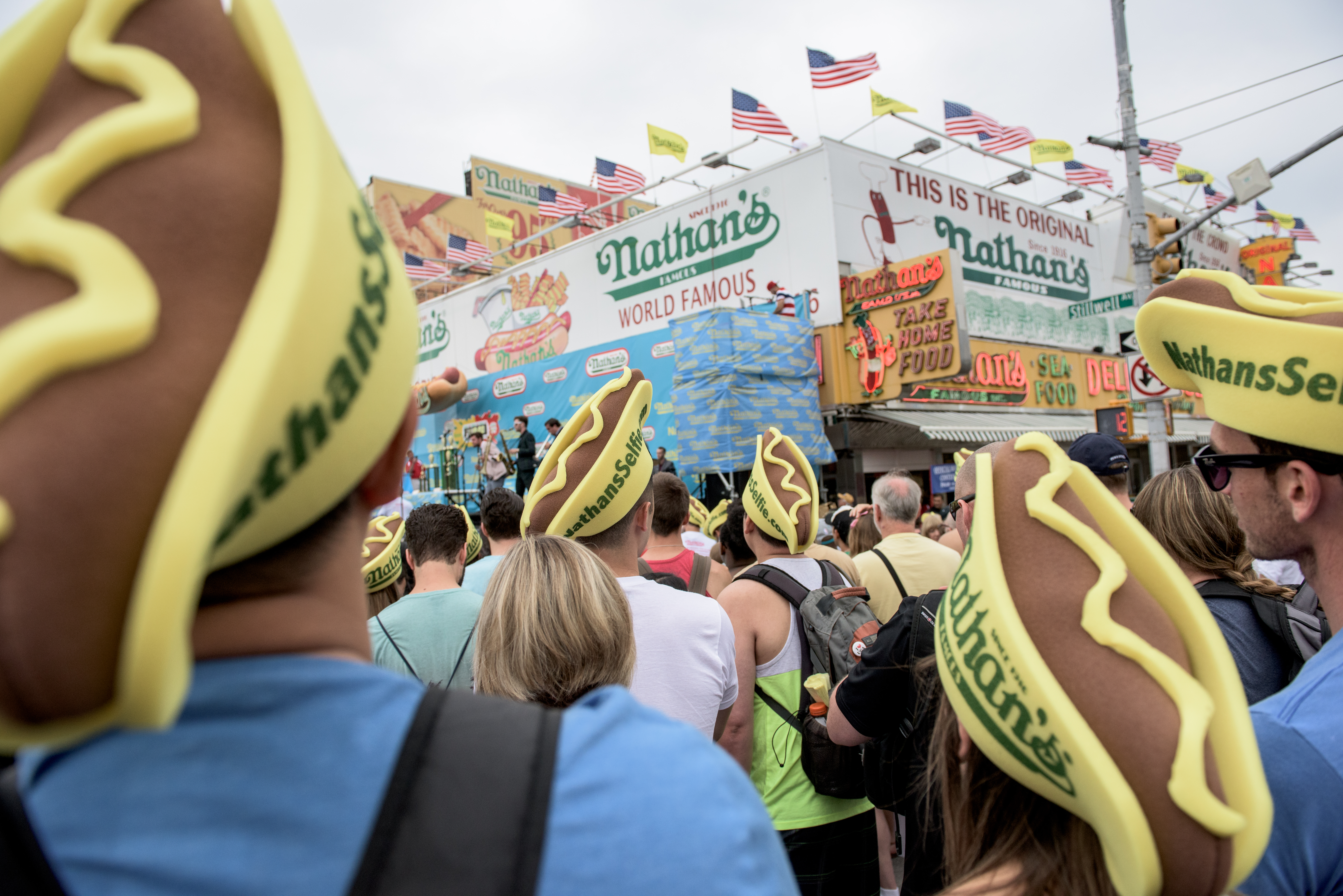 NEW YORK, NY - JULY 4: Fans gather at The Nathan's Famous Fourth of July International Hot Dog-Eating Contest in Coney Island, New York, on July 4, 2015. The contest is an annual Fourth of July tradition. (Photo by Andrew Renneisen/Getty Images)