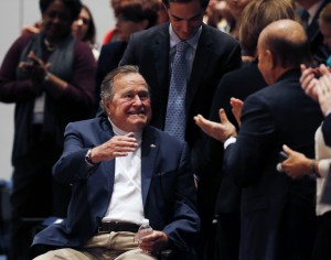 "Former United States President George H. W. Bush is brought into the auditorium where his son Former United States President George W. Bush speaks about his new book titled ""41: A Portrait of My Father"" at the George Bush Presidential Library Center in College Station, Texas November 11, 2014. REUTERS/Bob Daemmrich/Pool"