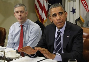 U.S. President Obama talks to the media next to Secretary of Education Duncan during a meeting with the Council of the Great City Schools Leadership at the White House in Washington