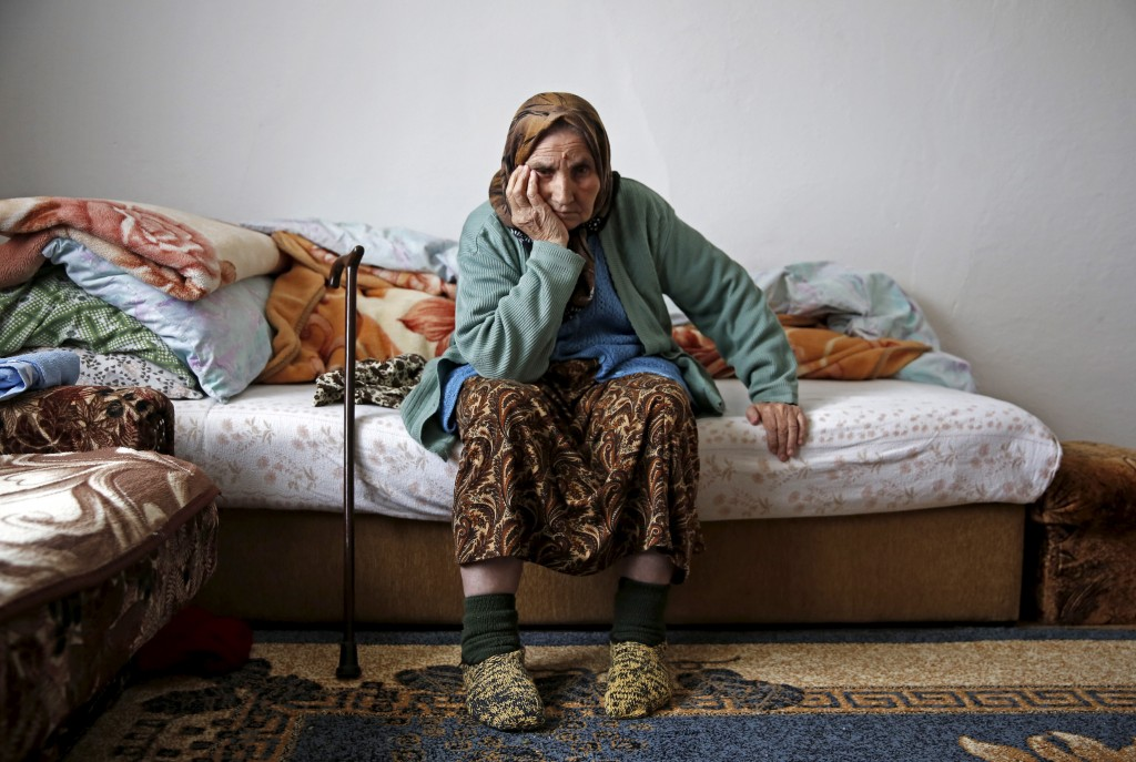 "Emina Osmanovic is seen in her home in a refugee camp Bisca near Banovici, Bosnia and Herzegovina, July 1, 2015. Emina is among several thousand women still searching for the remains of their closest relatives 20 years after the Srebrenica massacre of 8,000 Muslim men and boys. Emina Osmanovic, is still searching for her son. She lost 15 close family members. ""I don't know what is worst. To find his bones and know for sure that he was killed. That he is gone. Or this waiting. Suspense."" Picture taken on July 1, 2015. REUTERS/Dado Ruvic - RTX1IUDU"