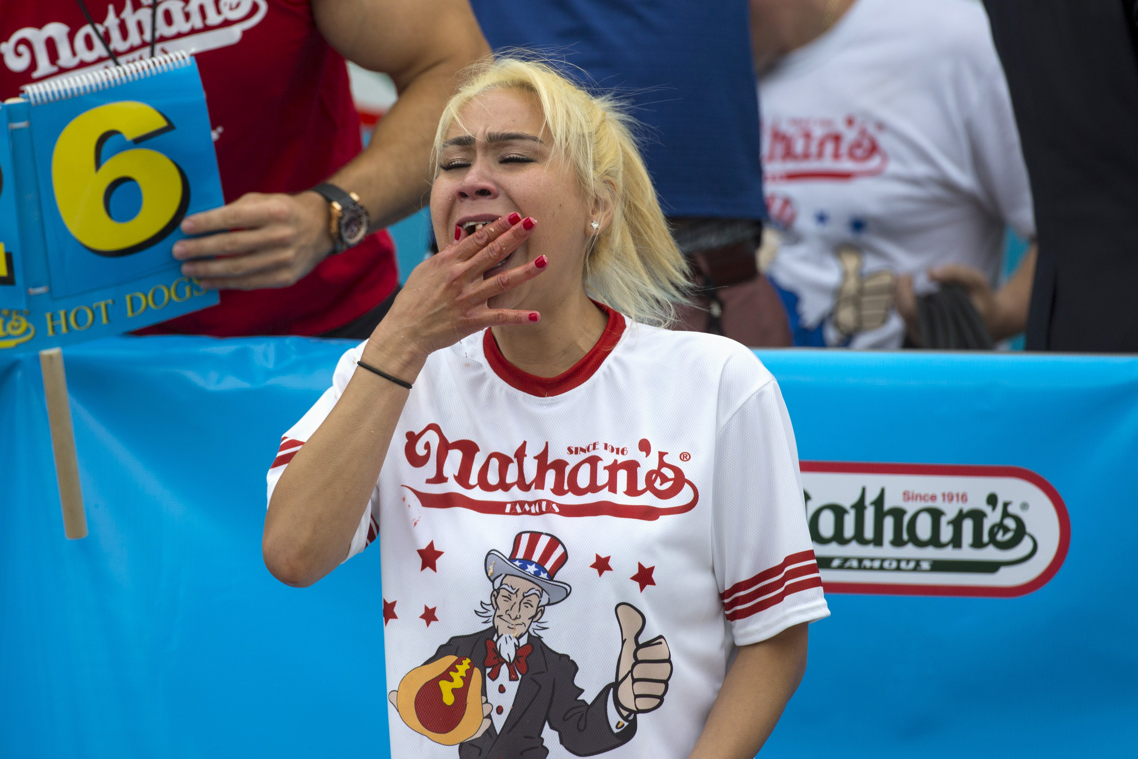 Miki Sudo, winner of Nathan's Famous Hot Dog Eating Contest in the Women's division, eats a hot dog during the competition in Brooklyn, New York July 4, 2015. Sudo finished with a total of 38 hot dogs consumed in ten minutes. REUTERS/Andrew Kelly - RTX1J065