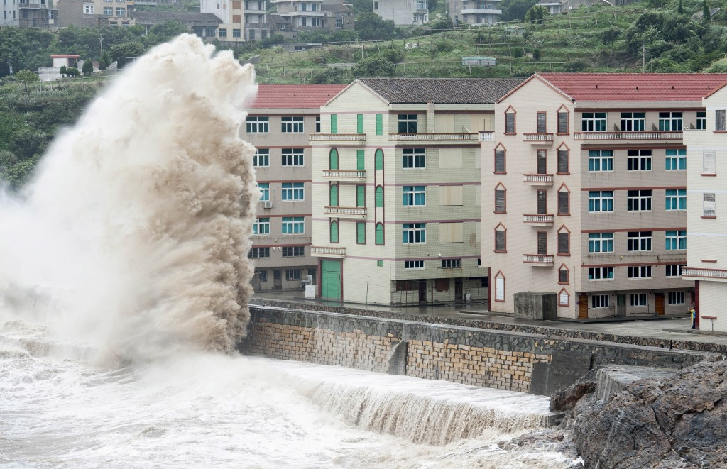 A wave from Typhoon Chan-hom hits the shore next to residential buildings in Wenling, Zhejiang province in China on July 10, 2015. Over 1 million people have been evacuated from coastal cities as the strongest typhoon in 35 years hits eastern China. Photo by Stringer/Reuters