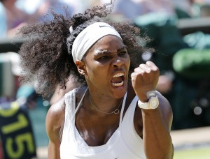Serena Williams of the U.S.A reacts after winning the first set of her Women's Final match against Garbine Muguruza of Spain at the Wimbledon Tennis Championships in London, July 11, 2015.                                              REUTERS/Suzanne Plunkett - RTX1JZQC